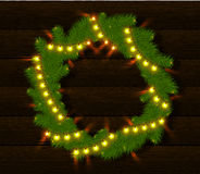 Christmas wreath with glow lights Royalty Free Stock Images