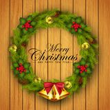 Christmas wreath with gold balls decorations, flower and gold bells on wood texture background Stock Photography