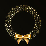 Christmas wreath from gold lights Stock Photos