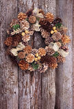 Christmas wreath in gold tones. On the old wooden textured wall with copy space stock photography