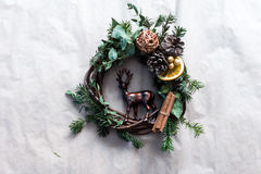 Christmas wreath with golden baubles and berries Stock Images