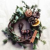 Christmas wreath with golden baubles and berries royalty free stock photo
