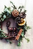 Christmas wreath with golden baubles and berries stock photography
