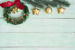 Christmas wreath with golden bells and red ribbon bow Royalty Free Stock Photo