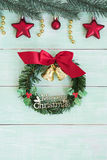 Christmas wreath with golden bells and red ribbon bow vertical Royalty Free Stock Photography