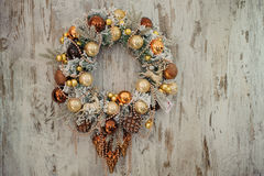 Christmas wreath with golden decorations Stock Images