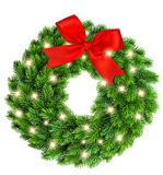 Christmas wreath with golden lights and red ribbon bow decoratio Royalty Free Stock Photo