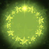 Christmas wreath of golden stars over green background with text Stock Photos