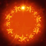 Christmas wreath of golden stars over red background Stock Photo