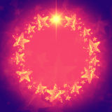 Christmas wreath of golden stars in violet and pink with text sp Stock Photography