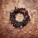 Christmas wreath on a golden wall,   fir branches Royalty Free Stock Photography