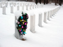 Christmas wreath on a grave Stock Photos