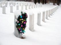 Christmas wreath on a grave Stock Photos