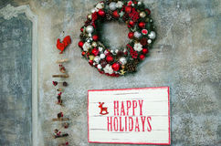 Christmas wreath on a gray wall Stock Image