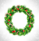 Christmas wreath on grayscale. Christmas wreath with holly sprigs, pine branches and candy canes in snowfall on grayscale background Royalty Free Stock Image