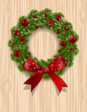 Christmas wreath. Green branch of fir with red balls and ribbon on a background of wood. Christmas decorations on the. Door. Vector illustration Royalty Free Stock Photography