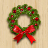Christmas wreath. Green branch of fir with red balls and ribbon on a background of wood planks. Christmas decorations. Texture of hardwood. Vector illustration Royalty Free Stock Photos