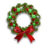 Christmas wreath. Green branch of fir tree with red, silver, green balls and ribbon on a white background. Christmas Royalty Free Stock Photography