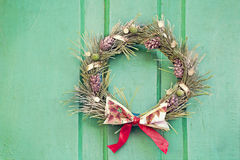 Christmas wreath on a green door. Stock Images