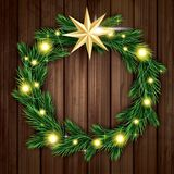 Christmas Wreath with Green Fir Branch, Light Garland and Golden Royalty Free Stock Image