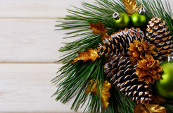 Christmas wreath with green ornaments, golden leaves and pine co Royalty Free Stock Images