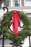 Christmas Wreath. A green Christmas wreath with red bow Royalty Free Stock Image