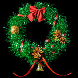 Christmas wreath. Green Christmas wreath with a red bow. Insulation Royalty Free Stock Image