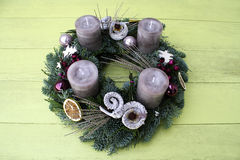 Christmas wreath with grey candles Royalty Free Stock Image