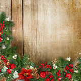 Christmas wreath on grunge wood texture with holly,firtree,vísc Stock Images