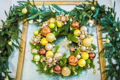 Christmas wreath handmade on a wooden background. New Year`s interior decoration stock photography