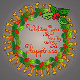 Christmas wreath, handwritten words Wishing You Joy and Happiness Stock Image