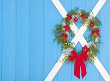 Christmas wreath hanging on a blue door Stock Photos