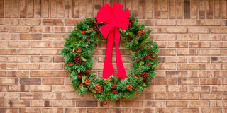 Christmas wreath  hanging on a  brick wall with co Stock Photography