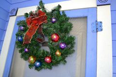Christmas Wreath Hanging on the Door. Of an early american home Stock Photo
