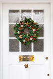 Christmas wreath. Hanging on door of a home stock image