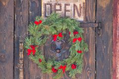 Christmas wreath hanging on the door royalty free stock photo
