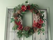 Christmas wreath hanging on front door stock image