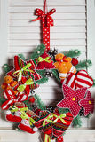 Christmas wreath hanging on wooden blinds Royalty Free Stock Photo