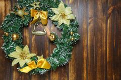 Christmas wreath hanging on wooden door front view. Decoration concept stock photo