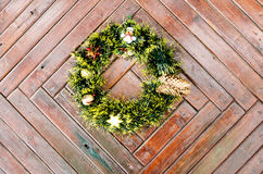 Christmas wreath hanging on a wooden door in winter Royalty Free Stock Photo