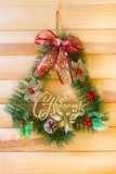 Christmas wreath hanging on a wooden wall Royalty Free Stock Photo