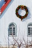 A christmas wreath haning on a building Stock Photos