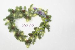 Christmas wreath in heart shape with flowers stock photo