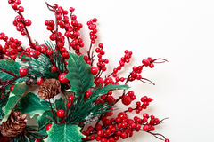 Christmas wreath of holly berries and evergreen isolated on white background Royalty Free Stock Photos