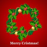 Christmas wreath with holly and decorations Royalty Free Stock Image
