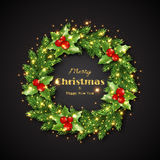 Christmas wreath with holly, glowing lights. Royalty Free Stock Photography