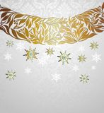 Christmas wreath with holly and snowflakes Stock Photos