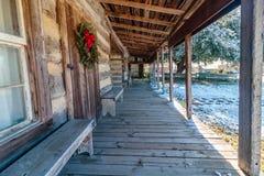 Christmas Wreath Hung on the Log Cabin Door Stock Photos