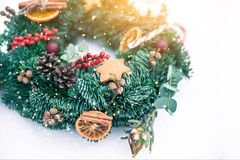 Christmas wreath isolated on a white snow background. Copy space stock photo