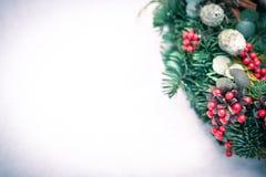 Christmas wreath isolated on a white snow background stock photos